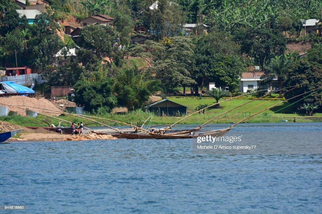 Th traditional three-hulled fishing boats in the Rubona Cove on lake Kivu : Stock Photo