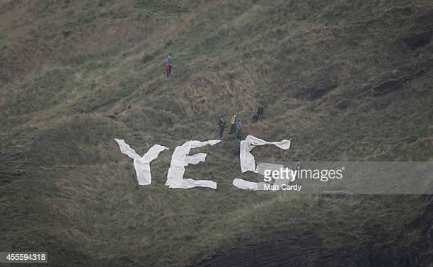 Th word yes is displayed from Salisbury Crags overlooking Edinburgh on September 17 2014 in Edinburgh Scotland The referendum debate has entered its...
