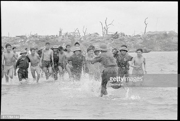 Tha Chi Han river near Quang Tri Vietnam North Vietnamese prisoners of war race to freedom across the Tha Ch Han River after being set free by the...