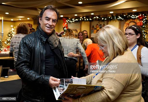 """Thaao Penghlis signs his autograph in the new book for fans at the""""Days Of Our Lives"""" book signing at the Titanic Museum October 31, 2015 in Pigeon..."""