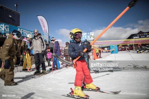 Thabang Mabari from Lesotho son of chief maintenance officer at Afriski in the Maluti Mountains of the Southern African Kingdom of Lesotho holds the...