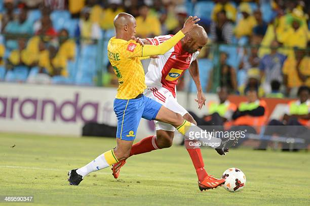 Thabo Nthethe of Mamelodi Sundowns and Nathan Paulse of Ajax Cape Town during the Absa Premiership match between Mamelodi Sundowns and Ajax Cape Town...