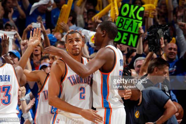 Thabo Sefolosha and Kevin Durant of the Oklahoma City Thunder celebrate against the Denver Nuggets on April 17 2011 in Game One of the Western...
