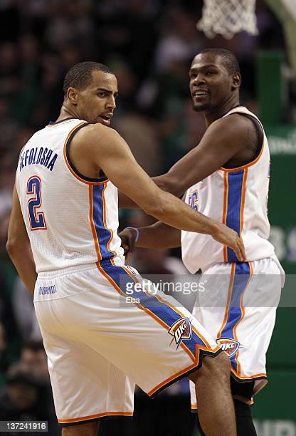 Thabo Sefolosha of the Oklahoma City Thunder celebrates his three point basket with teammate Kevin Durant on January 16 2012 at TD Garden in Boston...