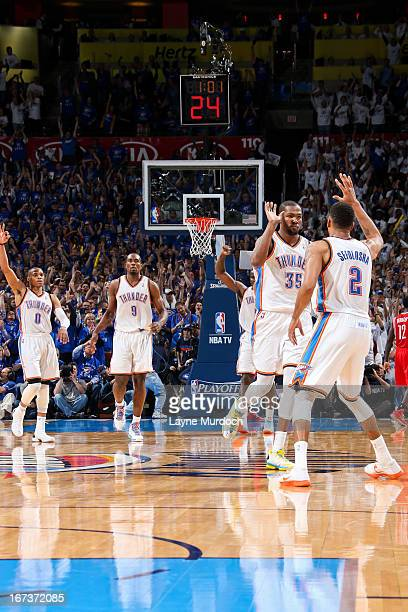 Thabo Sefolosha of the Oklahoma City Thunder celebrates with teammate Kevin Durant after making a threepointer late in the fourth quarter against the...