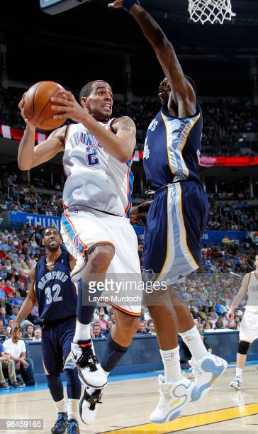 Thabo Sefolosha of the Oklahoma City Thunder does for a layup past Hasheem Thabeet of the Memphis Grizzlies on April 14 2010 at the Ford Center in...