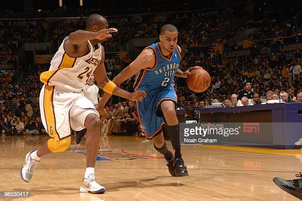 Thabo Sefolosha of the Oklahoma City Thunder dribbles against Kobe Bryant of the Los Angeles Lakers in Game One of the Western Conference...