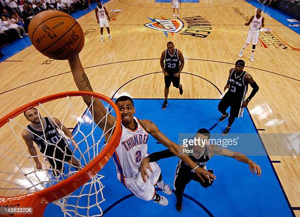 Thabo Sefolosha of the Oklahoma City Thunder dunks the ball against Daniel Green and Manu Ginobili of the San Antonio Spurs in Game Six of the...