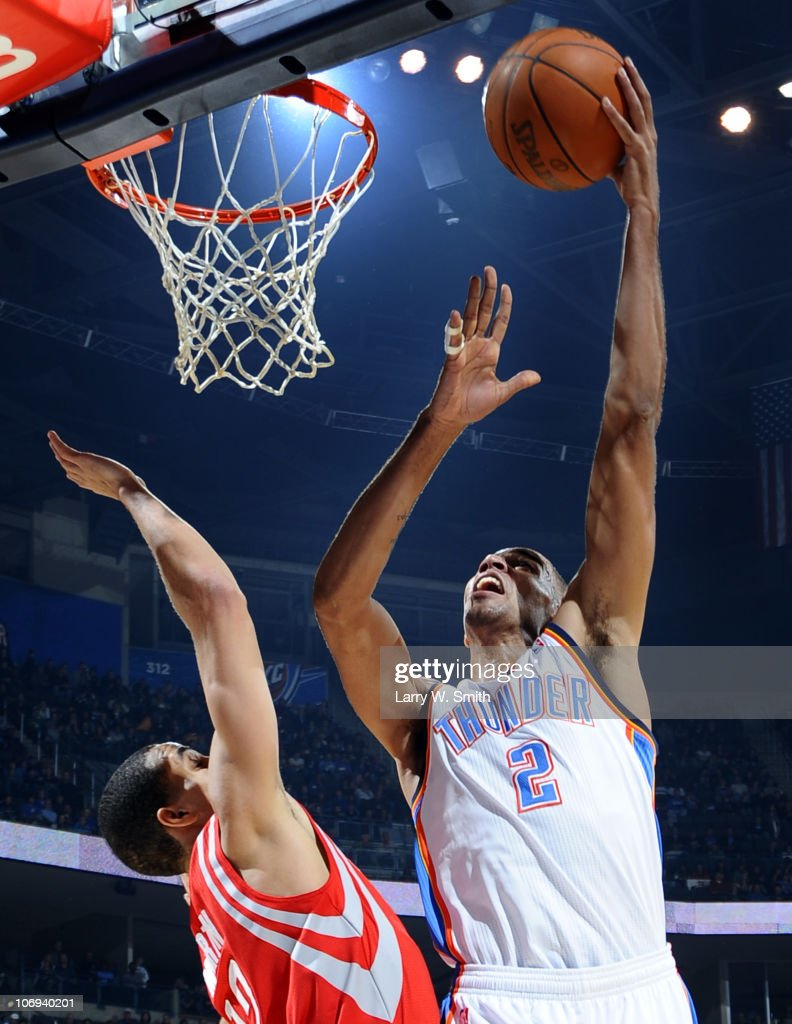 Thabo Sefolosha #2 of the Oklahoma City Thunder goes to the basket against Kevin Martin #12 of the Houston Rockets during the game at the Oklahoma City Arena on November 17, 2010 in Oklahoma City, Oklahoma.