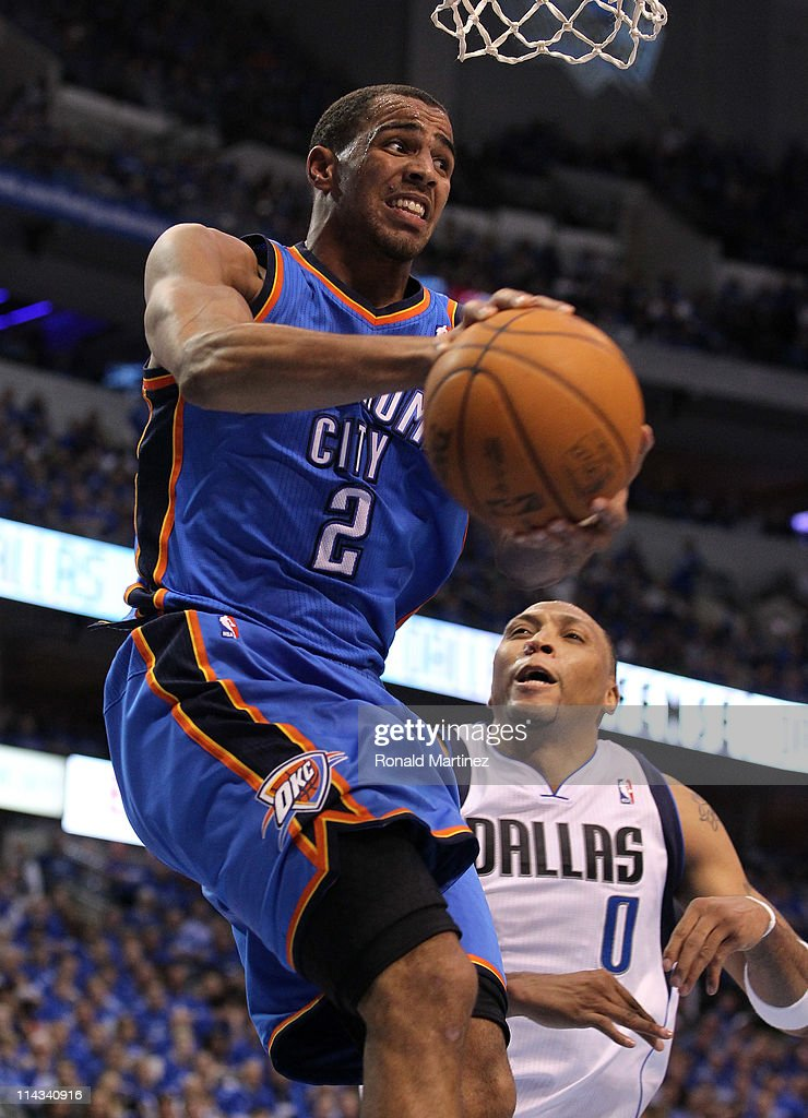 Thabo Sefolosha #2 of the Oklahoma City Thunder is under the basket with the ball against Shawn Marion #0 of the Dallas Mavericks in Game One of the Western Conference Finals during the 2011 NBA Playoffs at American Airlines Center on May 17, 2011 in Dallas, Texas.