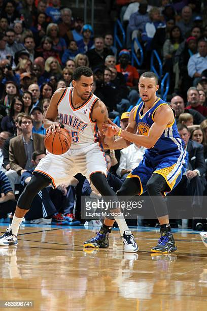 Thabo Sefolosha of the Oklahoma City Thunder moves around Stephen Curry of the Golden State Warriors during an NBA game on January 17 2014 at the...