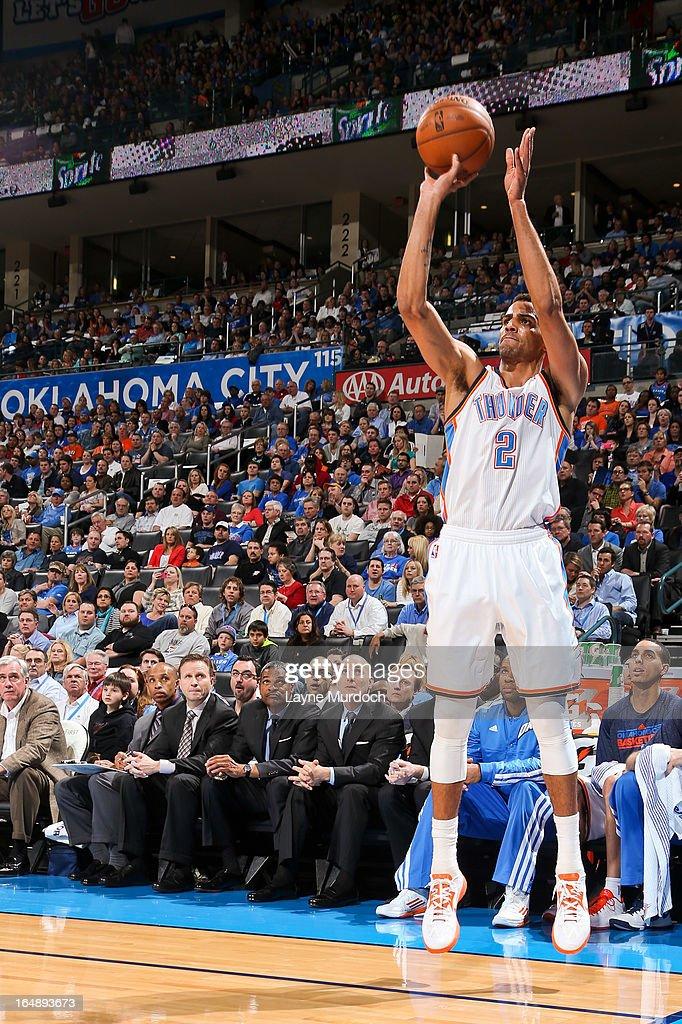 Thabo Sefolosha #2 of the Oklahoma City Thunder shoots a three-pointer against the Washington Wizards on March 27, 2013 at the Chesapeake Energy Arena in Oklahoma City, Oklahoma.
