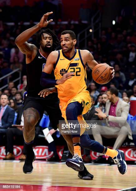 Thabo Sefolosha of the Utah Jazz drives past DeAndre Jordan of the LA Clippers during a 126107 win over the LA Clippers at Staples Center on November...