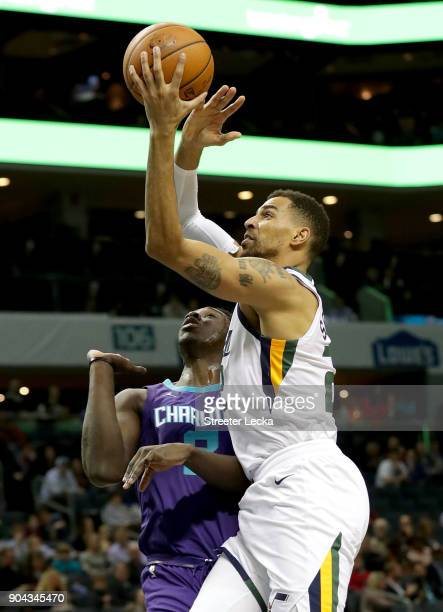 Thabo Sefolosha of the Utah Jazz drives to the basket against Johnny O'Bryant III of the Charlotte Hornets during their game at Spectrum Center on...