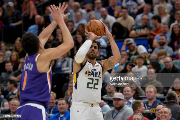 Thabo Sefolosha of the Utah Jazz shoots over Devin Booker of the Phoenix Suns during a game at Vivint Smart Home Arena on March 25 2019 in Salt Lake...