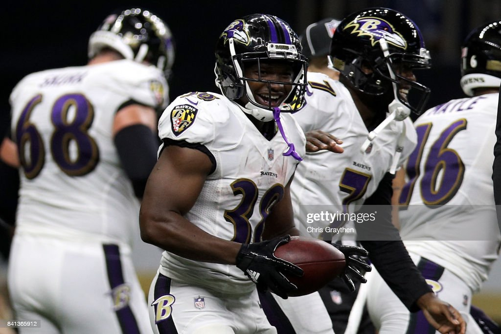 Thad Lewis #7 of the Baltimore Ravens and Bobby Rainey #38 of the Baltimore Ravens celebrate after a touchdown against the New Orleans Saints at Mercedes-Benz Superdome on August 31, 2017 in New Orleans, Louisiana.