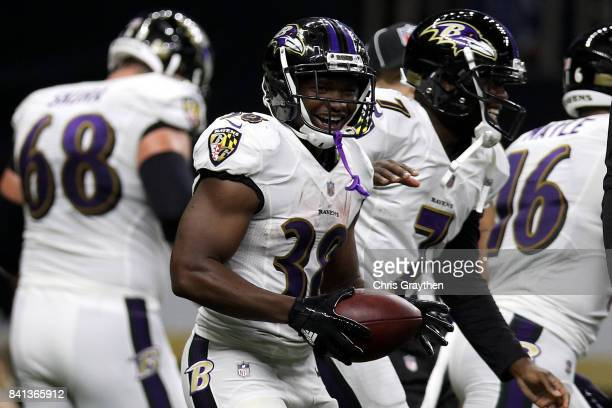 Thad Lewis of the Baltimore Ravens and Bobby Rainey of the Baltimore Ravens celebrate after a touchdown against the New Orleans Saints at...