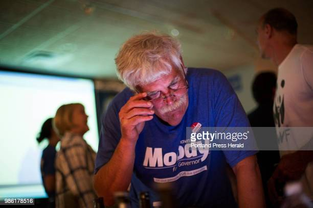 Thad Moody of Gorham brother of Maine gubernatorial candidate Shawn Moody looks at election results at Moody's Collision Center on Tuesday June 12...