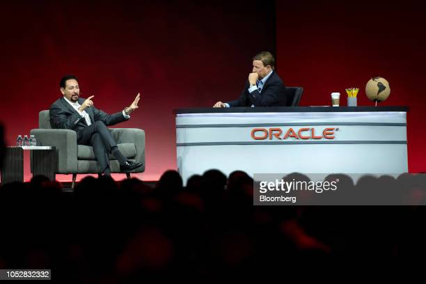 Thaddeus Arroyo chief executive officer of business solutions and international at ATT Inc left speaks while Mark Hurd cochief executive officer of...