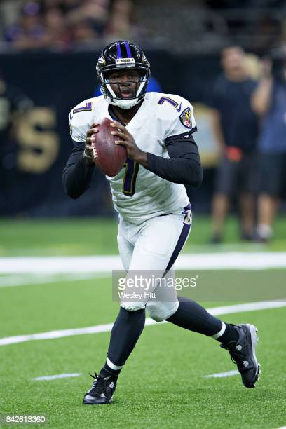 Thaddeus Lewis of the Baltimore Ravens rolls out looking for a receiver during a preseason game against the New Orleans Saints at MercedesBenz...