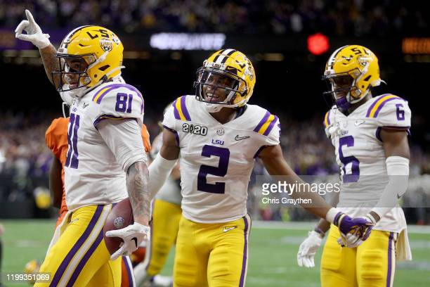 Thaddeus Moss of the LSU Tigers celebrates his touchdown with Justin Jefferson of the LSU Tigers against Clemson Tigers in the College Football...