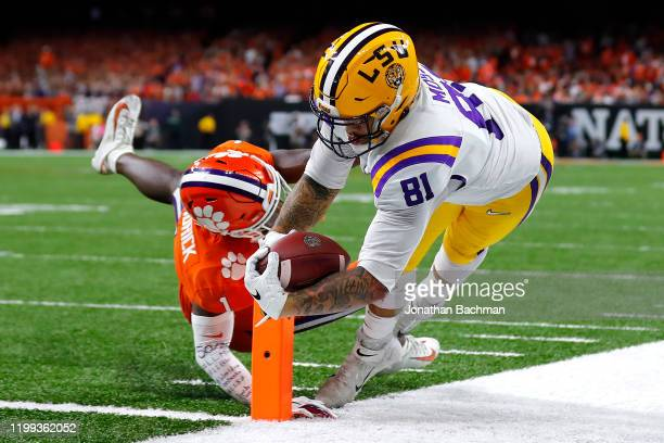 Thaddeus Moss of the LSU Tigers scores a touchdown against the Clemson Tigers during the third quarter in the College Football Playoff National...