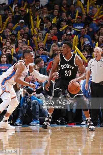Thaddeus Young of the Brooklyn Nets defends the ball against Russell Westbrook of the Oklahoma City Thunder during the game on November 25 2015 at...