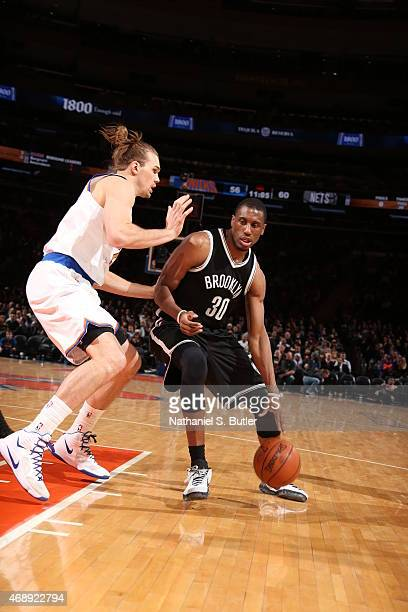 Thaddeus Young of the Brooklyn Nets dribbles against Lou Amundson of the New York Knicks on April 1 2015 at Madison Square Garden in New York City...