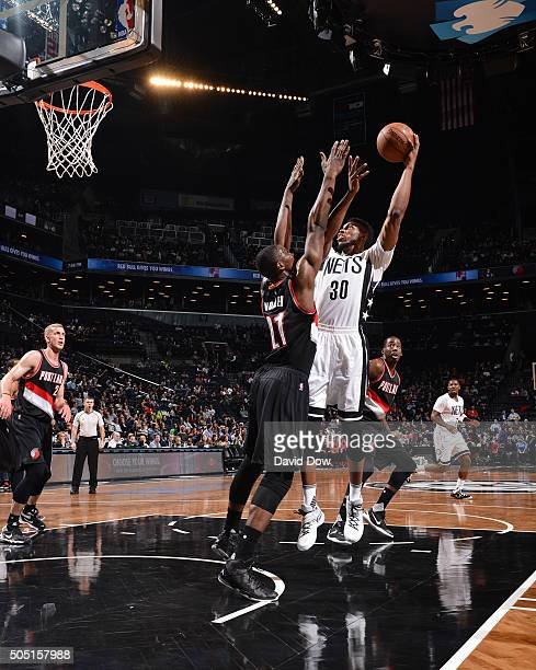 Thaddeus Young of the Brooklyn Nets goes up for the shot against the Portland Trail Blazers on January 15 2015 at Barclays Center in Brooklyn New...