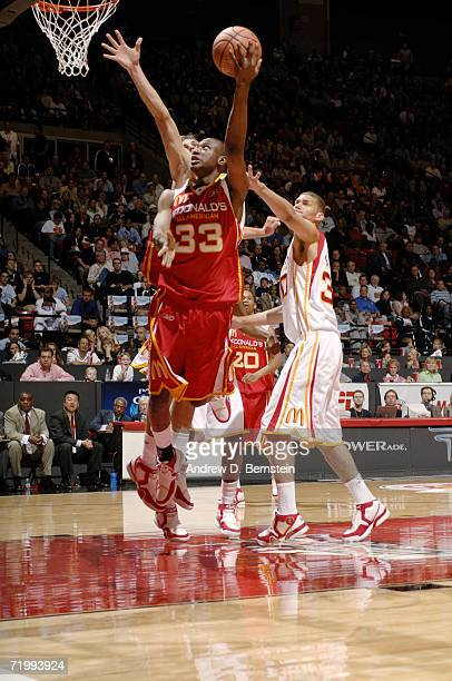 Thaddeus Young of the East shoots a layup against James Keefe of the West during the 2006 McDonald's All American High School Basketball game at Cox...