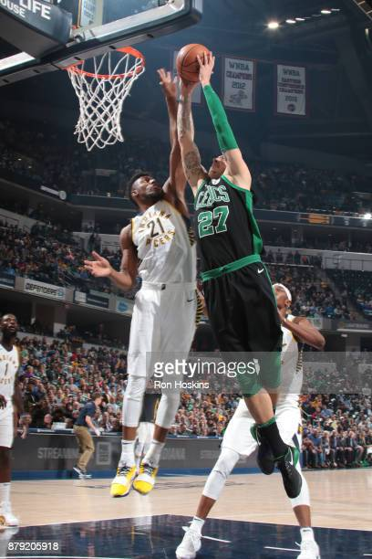 Thaddeus Young of the Indiana Pacers blocks the shot of Daniel Theis of the Boston Celtics on November 25 2017 at Bankers Life Fieldhouse in...