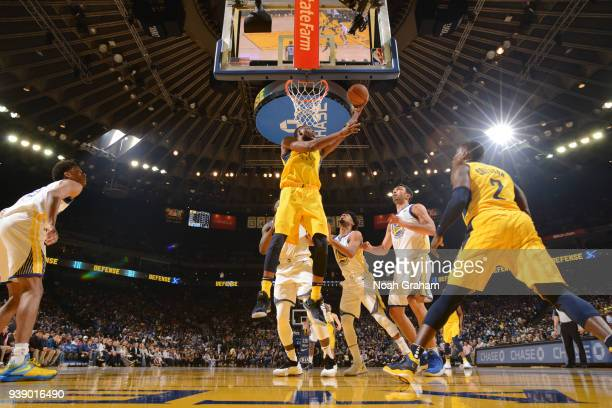Thaddeus Young of the Indiana Pacers goes to the basket against the Golden State Warriors on March 27 2018 at ORACLE Arena in Oakland California NOTE...