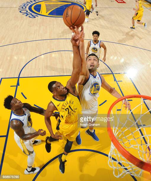 Thaddeus Young of the Indiana Pacers goes up for a rebound against Zaza Pachulia of the Golden State Warriors on March 27 2018 at ORACLE Arena in...
