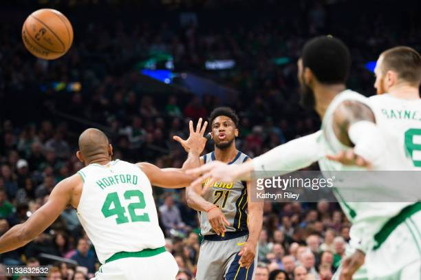 Thaddeus Young of the Indiana Pacers makes a pass through Al Horford and Aron Baynes of the Boston Celtics at TD Garden on March 29 2019 in Boston...