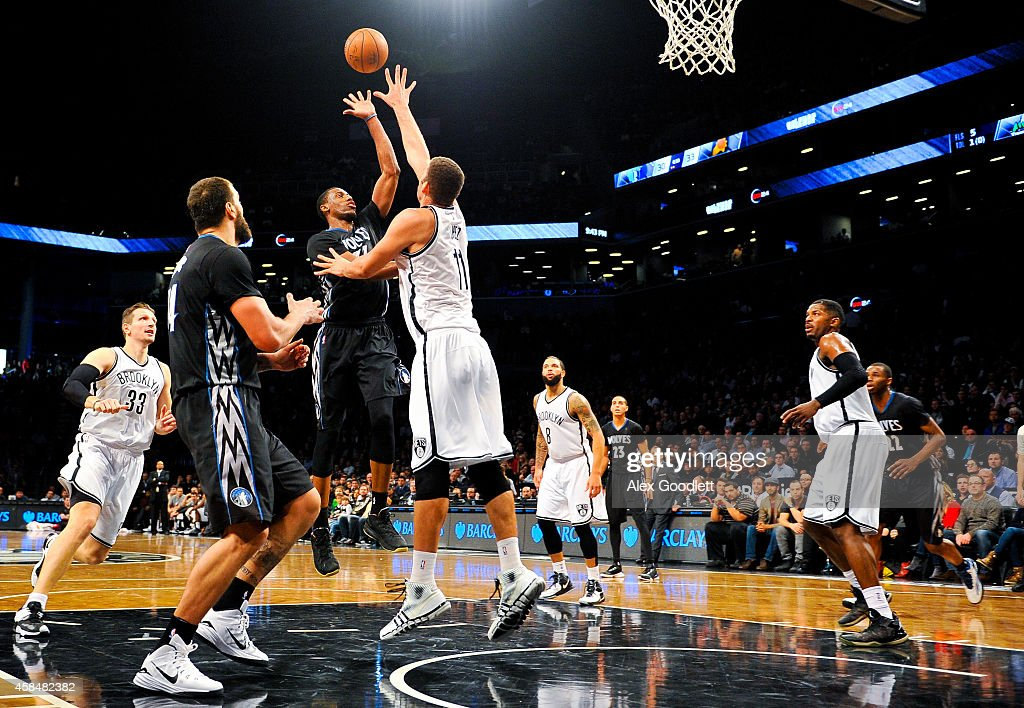 Thaddeus Young #33 of the Minnesota Timberwolves shoots over Brook Lopez #11 of the Brooklyn Nets in the fourth quarter at the Barclays Center on November 5, 2014 in the Brooklyn borough of New York City.