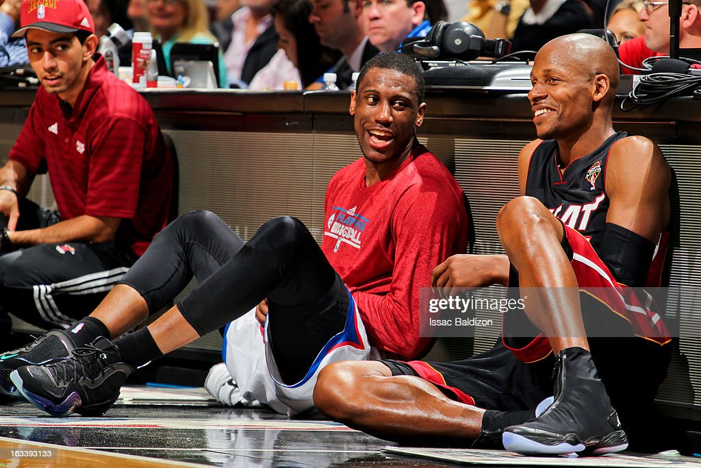 Thaddeus Young #21 of the Philadelphia 76ers and Ray Allen #34 of the Miami Heat speak before checking into their game on March 8, 2013 at American Airlines Arena in Miami, Florida.