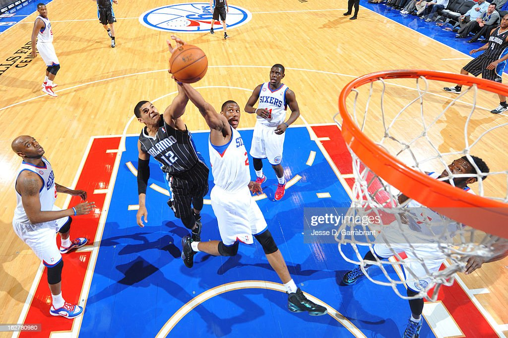 Thaddeus Young #21 of the Philadelphia 76ers blocks a layup from Tobias Harris #12 of the Orlando Magic at the Wells Fargo Center on February 26, 2013 in Philadelphia, Pennsylvania.