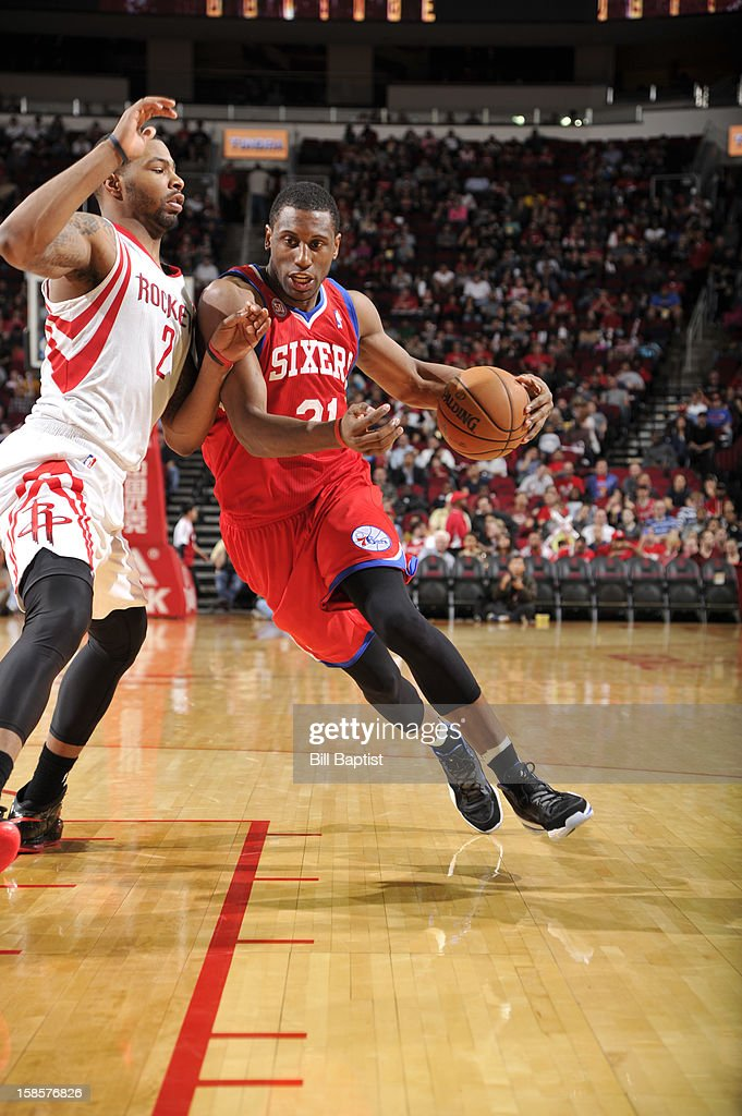 Thaddeus Young #21 of the Philadelphia 76ers drives the ball against Marcus Morris #2 of the Houston Rockets on December 19, 2012 at the Toyota Center in Houston, Texas.