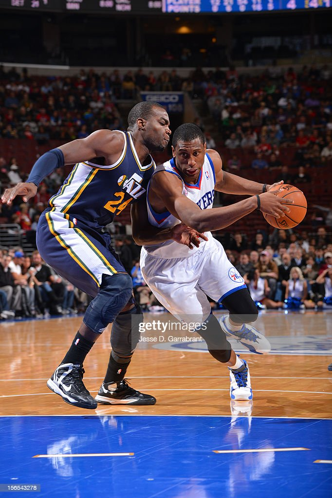 Thaddeus Young #21 of the Philadelphia 76ers drives to the basket against Paul Millsap #24 of the Utah Jazz at the Wells Fargo Center on November 16, 2012 in Philadelphia, Pennsylvania.