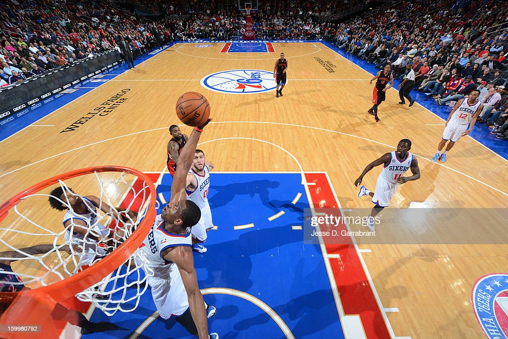 Thaddeus Young #21 of the Philadelphia 76ers grabs a rebound against the Toronto Raptors at the Wells Fargo Center on January 18, 2013 in Philadelphia, Pennsylvania.