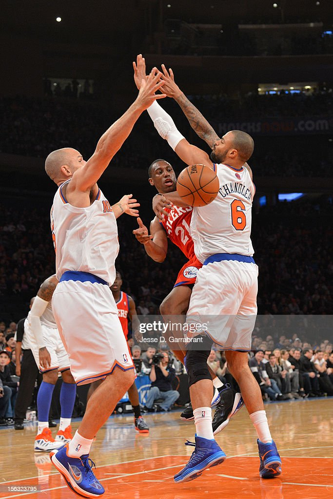 Thaddeus Young #21 of the Philadelphia 76ers makes a pass against Tyson Chandler #6 of the New York Knicks on November 4, 2012 at Madison Square Garden in New York City.