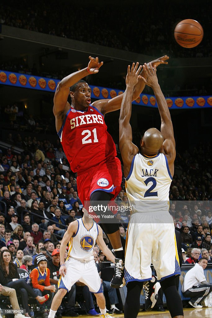 Thaddeus Young #21 of the Philadelphia 76ers passes the ball against Jarrett Jack #2 of the Golden State Warriors on December 28, 2012 at Oracle Arena in Oakland, California.