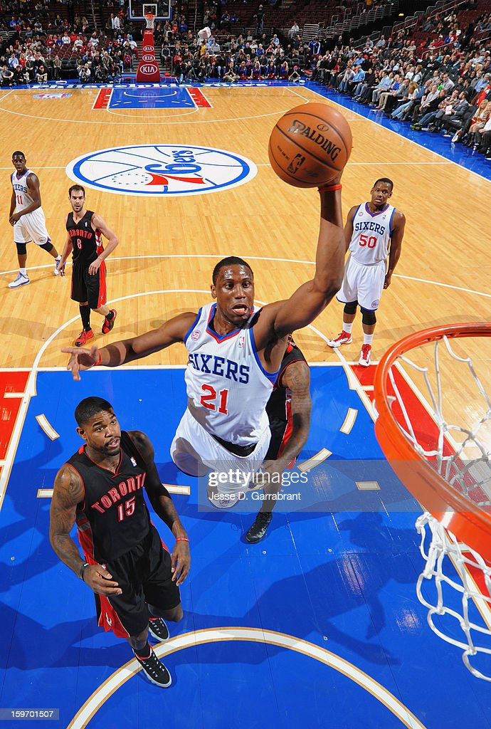 Thaddeus Young #21 of the Philadelphia 76ers shoots against Amir Johnson #15 of the Toronto Raptors during the game at the Wells Fargo Center on January 18, 2013 in Philadelphia, Pennsylvania.