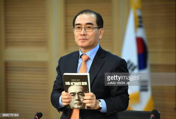 Thae Yongho who fled his post as North Korea's deputy ambassador to Britain in August 2016 poses with his memoir during a press conference for the...