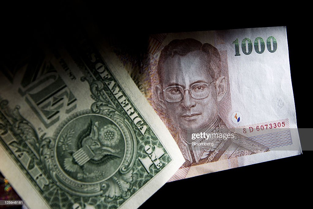 A Thai 1000 Baht Banknote And U S