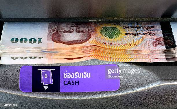 Thai 1000baht banknotes the highest denomination of the currency emerge from an automated teller machine in Bangkok Thailand on Wednesday March 5...