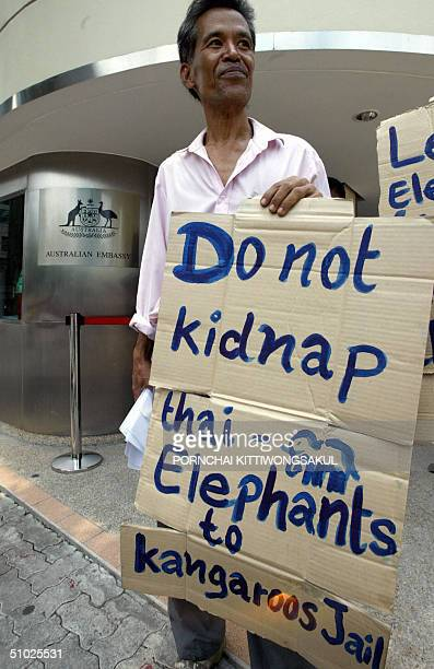 Thai activists hold banners during a protest of the bartering project of Thai elephants for koala bears in front of the Australian Embassy in Bangkok...