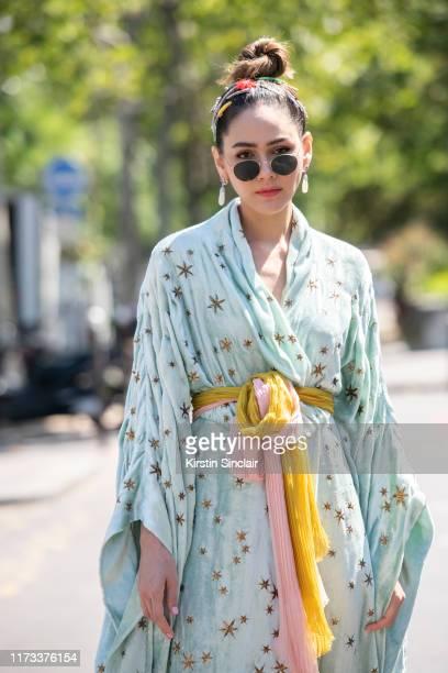 Thai Actress Araya Alberta wears a Gucci dress and Chopard earrings on July 03 2019 in Paris France