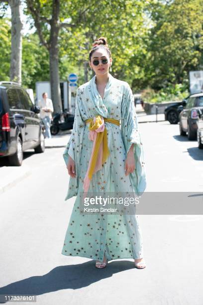Thai Actress Araya Alberta wears a Gucci dress Gianvito Rossi shoes and Chopard earrings on July 03 2019 in Paris France