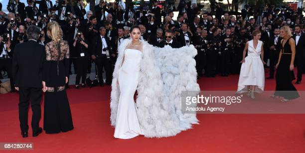 Thai actress Chompoo Araya arrives for the screening of the film 'Les Fantomes dIsmael' out of competition and the Opening Ceremony of the 70th...